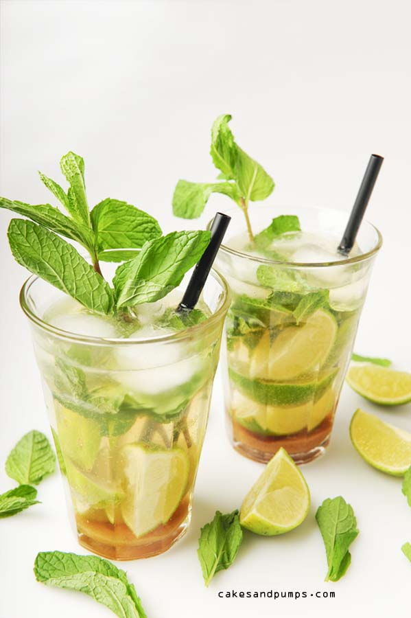 Mojito cocktail with rum, sugar, mint, lemon and sparkling water
